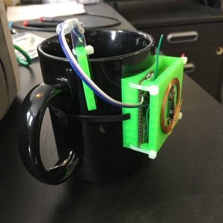 All the parts mounted in a 3D printed case, hanging on the coffee mug.