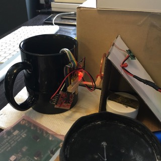 Inductive charger mounted on the coffee mug.